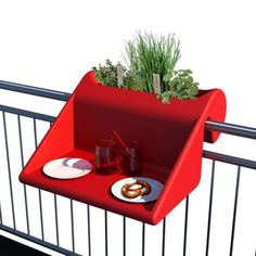 I love this simple concept. Balcony flower pot and table in one! Brilliant!