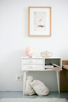 clean drawer and open shelf nightstand and simple art