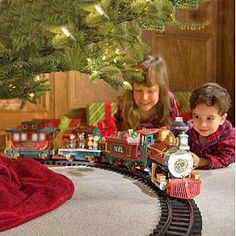Christmas Tradition at Grandma's, Train around the Christmas Tree until Santa came for his visit.