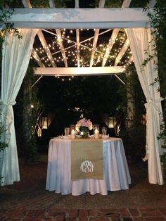 sweetheart table at outdoor wedding with burlap runner and monogram