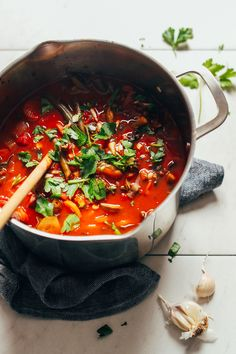 A big pot loaded with vegetables and broth for our Fire-Roasted Tomato Veggie Mung Bean Soup
