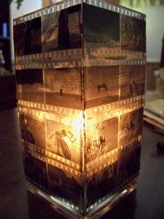 square glass vase, old negatives & modge podge & a candle on the inside.
