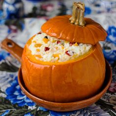 This Russian porridge with cream and dried berries is baked in a pumpkin and it makes a great holiday breakfast!