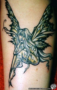 Fairy Tattoo # 83 - This is the best fairy tattoo we've ever seen, in which colors are infused in the best way. Fairy body is covered by a beautiful floral vines and see at her beautiful wings. It deserves both pin like:)