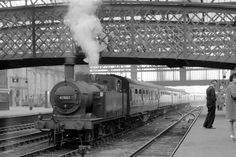 In pregrouping days Carlisle Citadel Station was host to no less than seven different railway companies, each with its own distinctive livery in shades of red, blue, green brown and black. It must have been a colourful place quite possibly remembered in his childhood, by the porter seen on Platform 3 in this pictureJinty 0.6.0T No 47667 stands on a siding with coaching stock on 21st April 1962 as a train in the background departs for the south from Platform 4. Out of picture to the right on… Blackpool England, Heritage Railway, The Porter, Steam Railway, Diesel Locomotive, Isle Of Wight, Cumbria, Carlisle, Great Britain