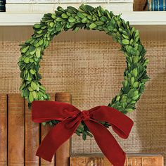 Hang thin boxwood wreaths, with removable adhesive hooks, on the fronts of built-in shelves for added flair.