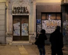 Hotel España    Two onlookers stroll past the boarded up Hotel España Photograph: James Boudra/GuardianWitness