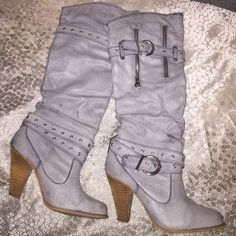 Light Grey Boots!! Light grey boots that Ive worn about 4 times, great condition. The heel is about 4 inches. There is zippers in the front as well as 2 belts which gives it some style. They slip on and off. Shoes Heeled Boots