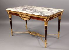 A Fantastic Quality Late 19th Century Louis XVI Style Gilt Bronze Mounted Center Table
