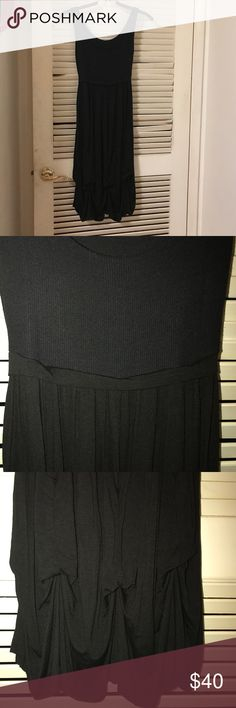 """Italian black summer dress Casual, light, soft, black summer dress made in Italy. Viscose and elastane. It ties loosely in the back. Fun shaping at the bottom. Bought it in Italy, never worn. One size. It should fit S and M. Armpit to armpit 13"""" to 16"""" stretched. Length from armpit to bottom 30"""". Dresses Midi"""