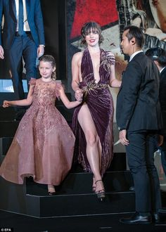 Making an entrace: The actress, who has starred in all five of the video game-inspired franchise's previous outings,stole the show at the event alongside her mini-me