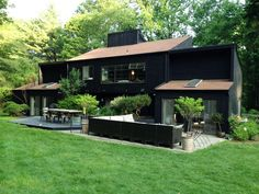 I really love a black stain exterior ....                        this one is Sherwin Williams Tricorn black woods capes stain