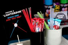 "candies for the dark side and good side- air heads and glow in the dark ""wands"""