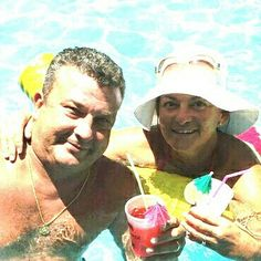 """Summer  2015 .*Pool time ,tiny umbrellas not a cloud in sight. Holding  Pat """"O Brian  hurricanes"""