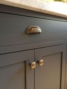Kitchen cabinets: Urbane Bronze by Sherwin Williams and antique brass hardware. Wrong hardware but like paint color Painting Kitchen Cabinets, Kitchen Paint, Kitchen Redo, New Kitchen, Kitchen Remodel, Brass Kitchen, Bathroom Cabinets, Kitchen Island, Kitchen Handles