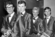 The Shadows pictured in 1960 wearing the Italian (tonic) bumb-freezer Suits that had started to become fashionable in 1958 heralding a decline in the wearing of the longer drape jacket worn by Teddy Boys.  These suits were generally worn with 'Winklepicker' shoes. The mohair tonic suit was later adopted by the Mods of the 1960's.