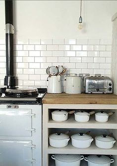 Between this pretty kitchen and those Le Creuset pots, something caught my eye... :)