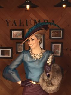 Camel coloured fur felt fedora with teal ribbon and real and burgundy pheasant feather accents www.marilynvandenberg.com