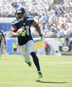 Wide receiver Percy Harvin #11 of the Seattle Seahawks carries the ball into the endzone for a touchdown against the San Diego Chargers at Qualcomm Stadium on September 14, 2014 in San Diego, California.