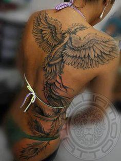 Black ink phoenix tattoo on back