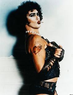 Frank N Furter - Tim Curry in Rocky Horror.  So sexy - that eyebrow, those lips!