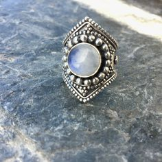A beautiful circular piece of moonstone surrounded by incredibly detailed silver…
