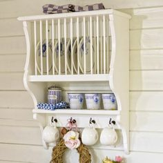 The one my husband made me has the hooks under the plate rack, not on the wall side of it.  It's uncanny how similar this is to what I asked him to create for me.  :)