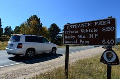 ESTES PARK, CO - SEPTEMBER 25: Cars drive into Rocky Mountain National Park in Estes Park, CO on September 25, 2014.   National park fees may be going up.