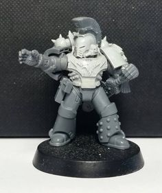 Veteran Sergeant wearing artificer armour gifted to him for his actions during the Unification Wars.
