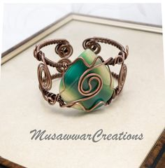 Antique Copper Wire wrapped bracelet cuff  by MusawwarCreations