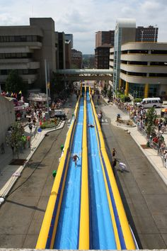 Every summer in Grand Rapids, Michigan the world's largest inflatable water slide is built in the heart of downtown. At this thing is. Does this really happen? I've never seen it. It looks like Michigan St. The Mitten State, Michigan Travel, Western Michigan, Water Slides, Great Lakes, Malaga, Summer Fun, Worlds Largest, Places To Go
