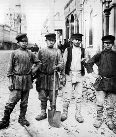 "1900's Moscow ~ young boys proudly pose for the camera on Ilyinka Street,sporting their tools of trade,they are employed to to do street maintenance. ""AL"""