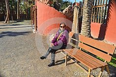 A Woman Sitting On A Bench - Download From Over 28 Million High Quality Stock Photos, Images, Vectors. Sign up for FREE today. Image: 48307844
