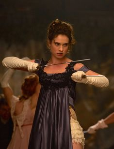 Lily James as Elizabeth Bennet in Pride and Prejudice and Zombies (2016).