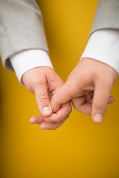Grooms holding hands | Washington, D.C. Rooftop Gay Wedding | Equally Wed - LGBTQ Weddings