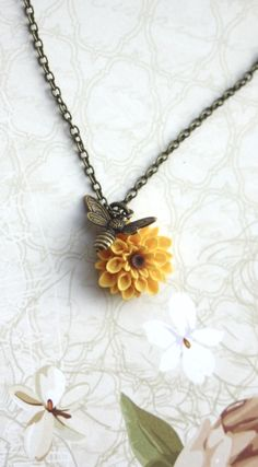 Flying Bee Necklace. Bee and Sunflower, Honey Bee and Yellow Mum, Chrysanthemum Flower Necklace. Bee Lover Gifts. Summer Bee Garden Wedding by MAROLSHA - https://www.etsy.com/listing/74857542/flying-bee-necklace-bee-and-sunflower?ga_search_query=sunflower&ref=shop_items_search_4