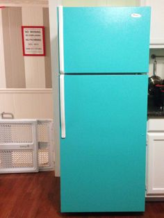 Its amazing what a little paint can do to an outdated fridge. Super cute!