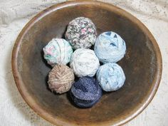 The beauty in simple country print fabric rag balls ~ they shout charm @ Vintage Touch $13.00