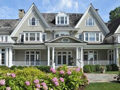 Perfectly perfect home!  Love the windows, peaks and porches!
