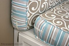 How to Reupholster the Cushions in Your Camper:  Wrap around zippers make it easy to get the cushion it and out of the cover for washing.  A neat pocket hides the zipper pull.