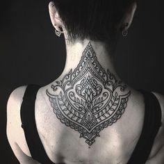 Neck piece tattoo black work... By Ellemental Tattoos