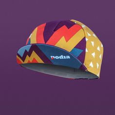 A classic lightweight cycling cap features bright colours of Podia and the five-panel structure with an elasticated band ensuring that one size fits all.  Designed in the UK, produced in Italy.