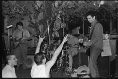The Minutemen, Grandia Room, Hollywood, CA, 1982. Most of the few people in the crowd played in other SST bands. At left is Earl Liberty from Saccharine Trust, center is Henry Rollins, and at right (in trucker hat) is Chuck Dukowski from Black Flag.