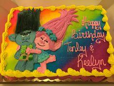 Whipped icing trolls cake