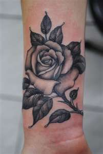 Like this but curling up to forearm with a touch of colour and possibly some lettering.