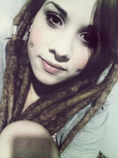I'd love cheek piercings and dreads!
