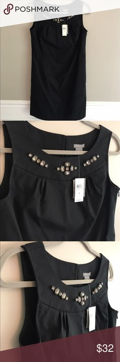 New NWT Ann Taylor black shift dress sparkle New with tags attached never worn Ann Taylor size 4 shift dress. Sleeveless with pretty faux jewel sparkle detail around neckline. Has pockets! Subtle pleated detail around neckline also. Smoke free pet free home. Measures approx 17 inches across pit to pit. 35 1/4 inches length. Lined. 96% cotton 4 % spandex. Dry clean. Side zipper closure. Button closure on back upper near base of neck. Ann Taylor Dresses
