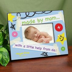 "Cute frame for a baby shower: ""Made by mom with a little help from dad."""