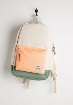Embark on a journey of stylish practicality with this trusty backpack from Herschel Supply Co. Colorblocked in hues of peach, ivory, and sage-green, this sturdy bag features a padded laptop pocket and leather zipper pulls for plenty of totable excitement!