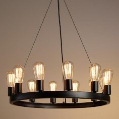 Crafted of iron with an industrial-style black finish, our exclusive round chandelier fills a room with the rustic warmth of 12 Edison lights - included for a brilliant value.